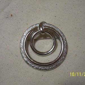 GIVENCHY VINTAGE SILVER TONE ROUND PIN BROOCH